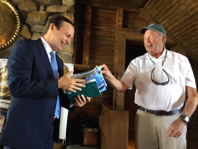 UConn Prof. Charles Yarish gives book about Long Island Sound to Sen. Murphy.