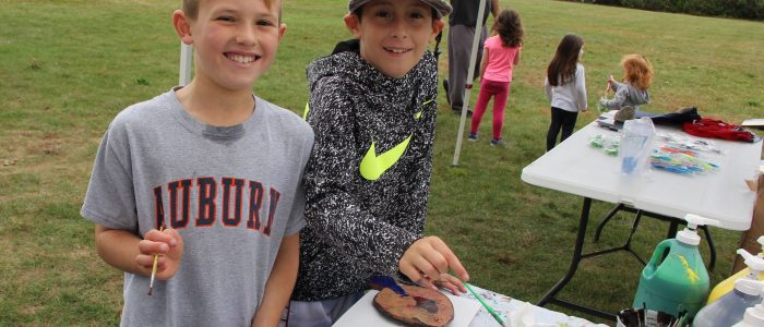 Riley Mazula, left, and Alex Picardi, both of Waterford, pint fish prints at the CT Sea Grant booth at UConn Avery Point's 50th anniversary celebration Oct. 15.