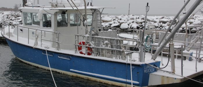 The R/V Lowell Weicker, used by CT Sea Grant researchers, is docked at the UConn Avery Point campus on a snowy December day.
