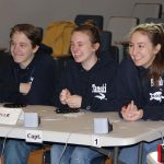Members of the Plainville High School team share a laugh between rounds.