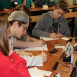 Norwich Free Academy team members compete in the timed short-answer portion of the contest.