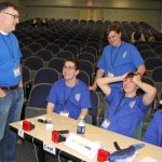 Waterford High team Coach Michael O'Connor confers with students during a break in the competition.