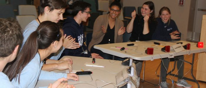 The first-place Quahog Bowl team from Ledyard High School, left, and the second-place team from Glastonbury High both applaud Ledyard's win in the Feb. 3 contest at UConn Avery Point.