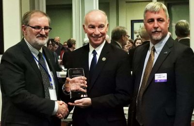 Rep. Joe Courtney, center, receives the Sea Grant Association Special Recognition Award from James Hurley, president of the association and director of Wisconsin Sea Grant. On Courtney's right is Sylvain De Guise, director of Connecticut Sea Grant.