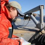 Kristin DeRosia-Banick records the time and date of the oyster sample collection.