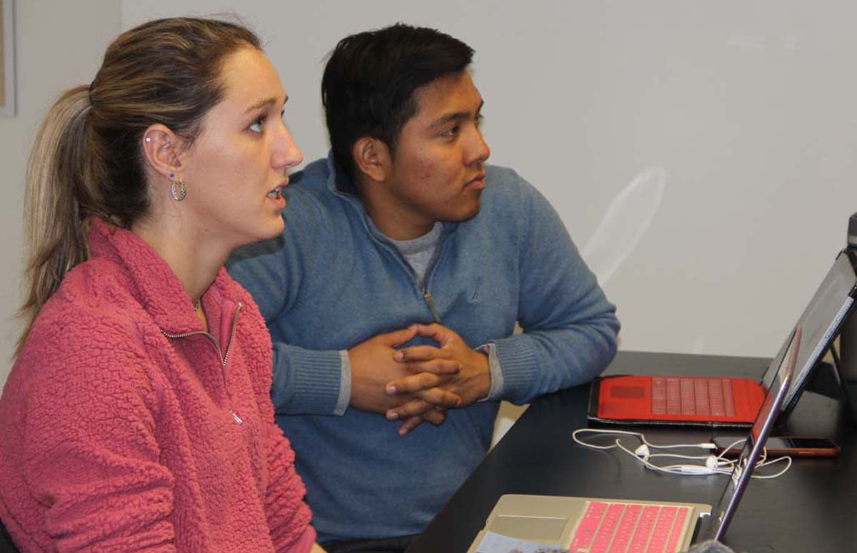 Adelaine McCloe and Tony Arreaga, describe their project for towns with neighborhoods of beaches, marinas and waterfront homes during the March 29 class at the UConn campus in Storrs.