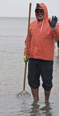 Rainy weather didn't deter the hardy clammers from taking part in the clamming clinic. Photo: Judy Preston