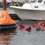 Trainees reach the life raft.