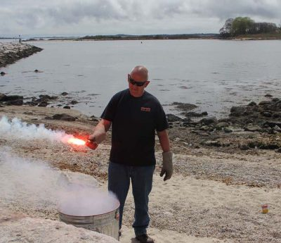 Ted Williams, marine safety coordinator with Hercules SLR Inc., shows one of several kinds of emergency flares.