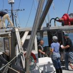 Fishermen practice an abandon ship drill aboard Michael Theiler's vessel during drill conductor training on May 11.