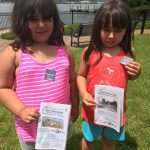 Fort Griswold Quest participants show off the stickers they earned for finding the treasure.