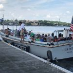 A boatload of Quest participants leaves the dock near Fort Griswold.