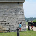 Quest participants count the openings in the blockhouse at Fort Trumbull to solve one of the clues.
