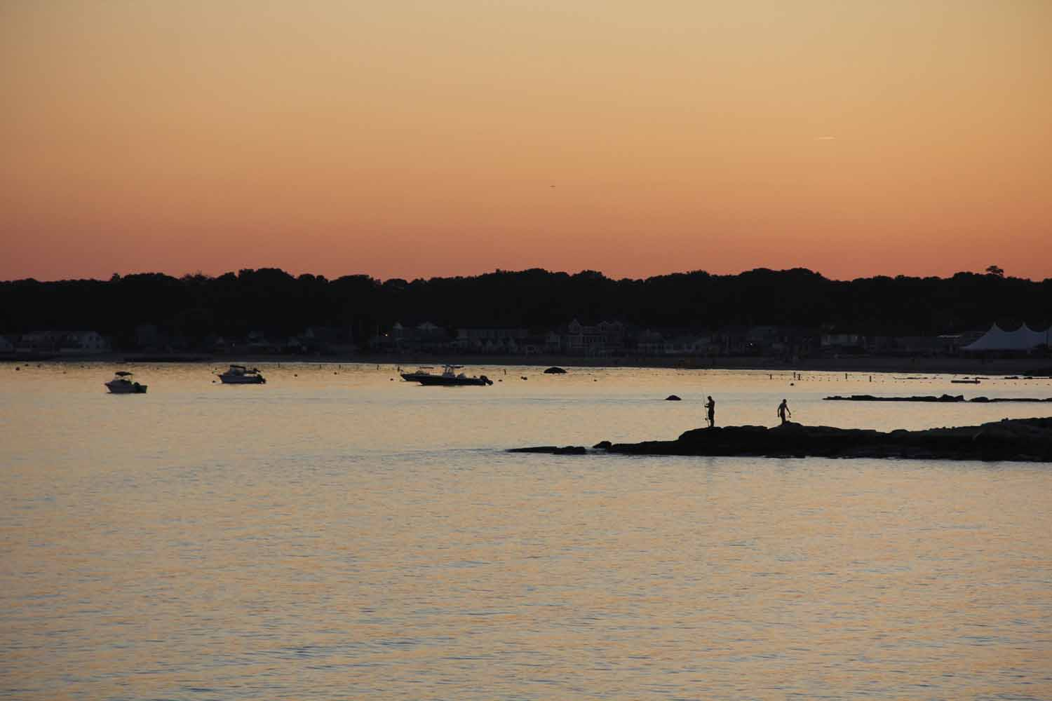 Sunset over Hatchetts Point in Old Lyme as fishermen head in for the night.