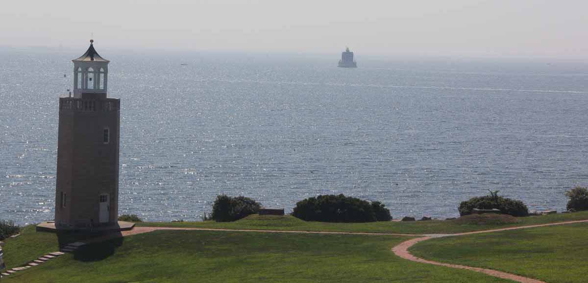 Avery Point Light, left, and Ledge Light, center, are two of the three lighthouses visible from campus.