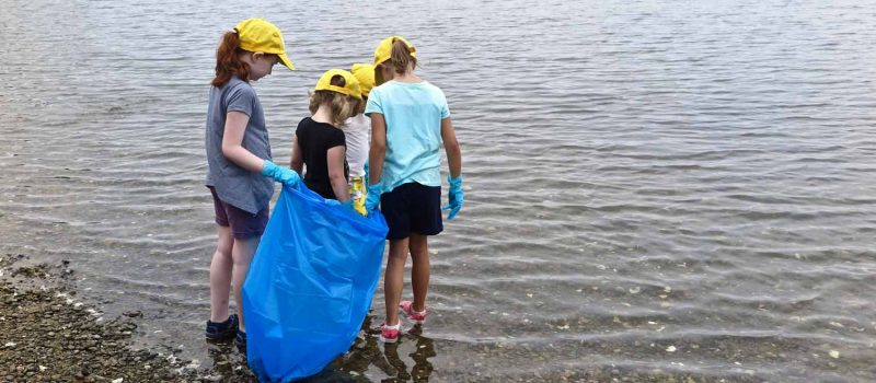 Mystic Aquarium summer campers look for trash on the shoreline at Bluff Point State Park on Aug. 1 to help launch the #DontTrashLISound campaign.
