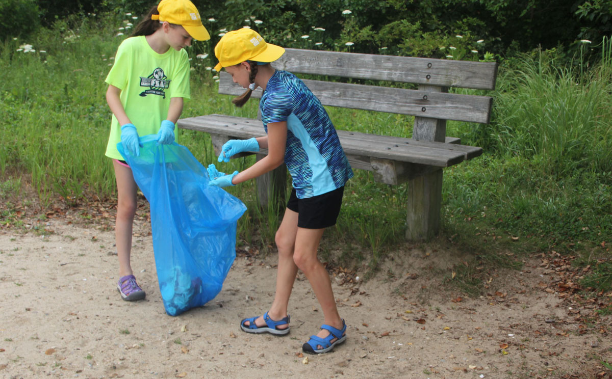 Maya Fisher and Charlotte Preuss collected numerous cigarette butts around a bench at Bluff Point State Park during the cleanup.