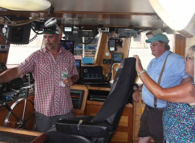 Aaron Williams, captain of Tradition, talks to visitors about his vessel during the open house. His vessel fishes for squid, scup and fluke.