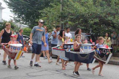 Students in New England Science & Sailing marched in the parade in boat costumes.