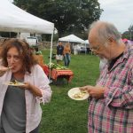 Alisa Mierejewski and Chip Dahlke enjoyed the free samples of pesto-encrusted scup with warm summer salad.