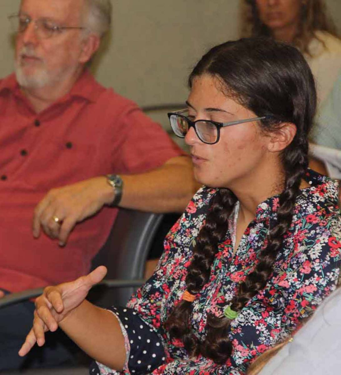 Emily Kollmer, a recent graduate of the marine vertebrate biology program at Stony Brook University, asks a question during the forum.