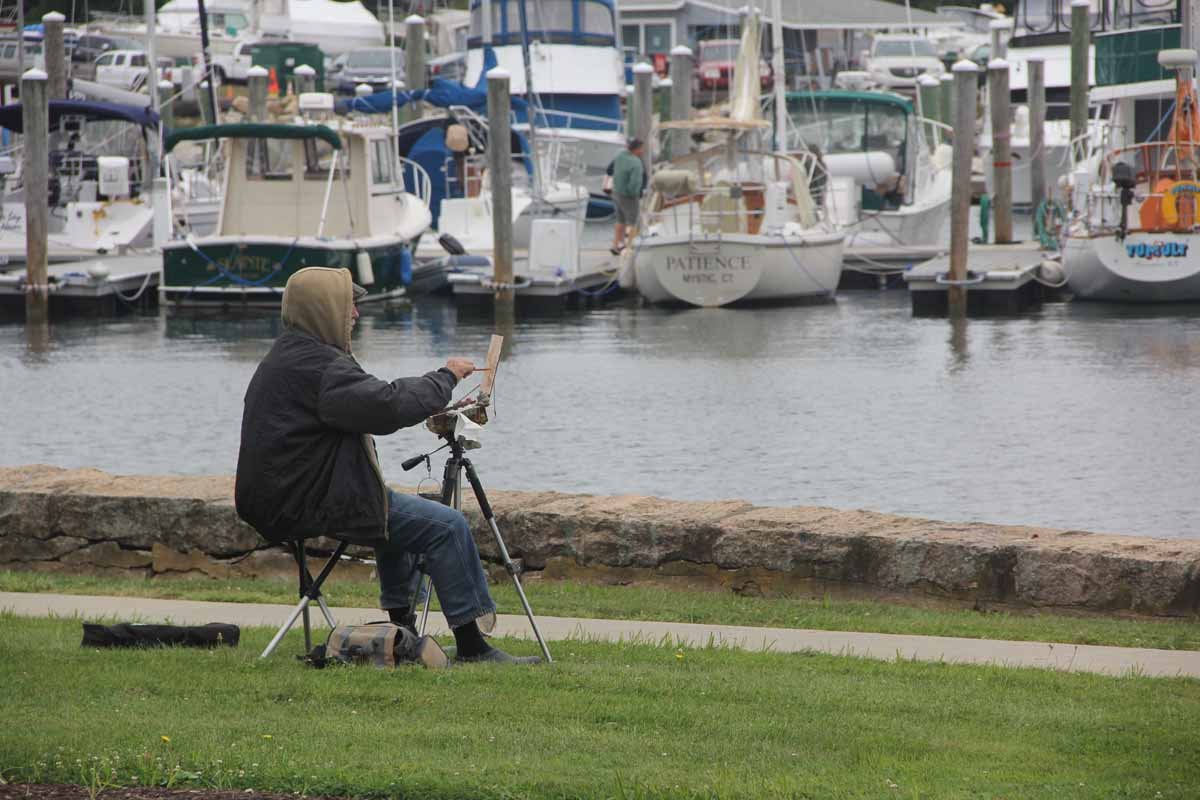 Doug Andersen of Simsbury set up his easel near the seawall between the campus and the Shennecossett Yacht Club.