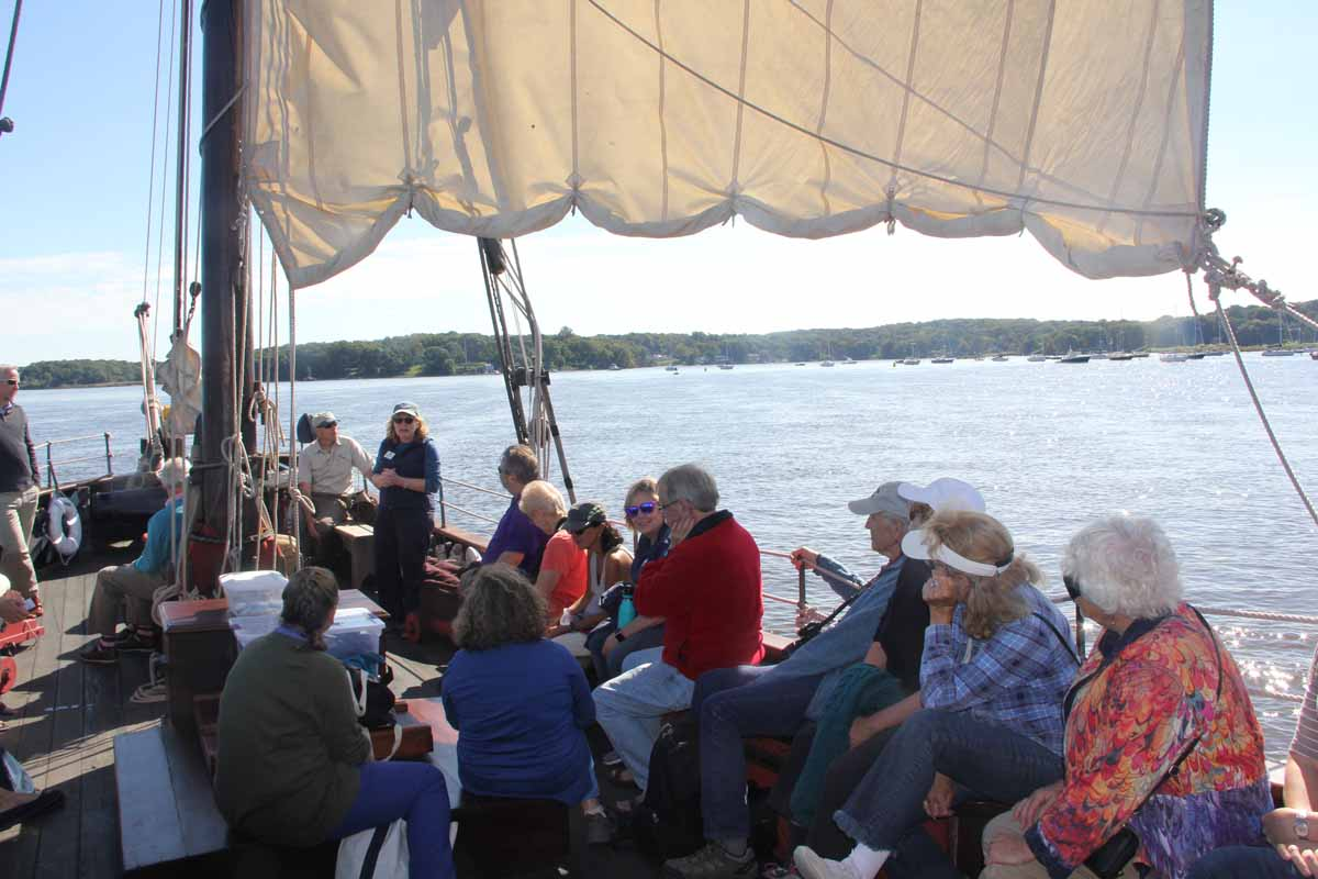 CT Sea Grant Associate Director Nancy Balcom, standing in the center, welcomes passengers to the on-the-water workshop.