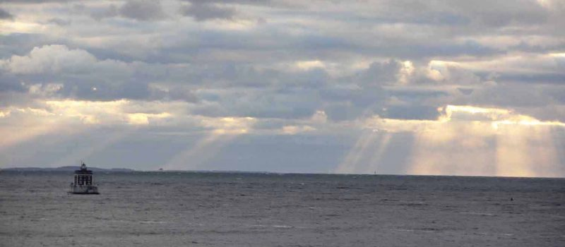 Sunlight streams through clouds over Long Island Sound near Ledge Light in the late afternoon on Nov. 27.
