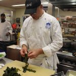 Chef Jeff Trombetta separates leaves of kelp before chopping.
