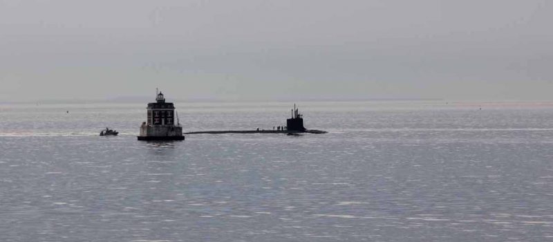 Heading home for the holidays: a submarine passes by Ledge Light on its way to the Naval Submarine Base in Groton on Dec. 20.