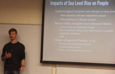 Nelson Durkee, a student in the Climate Corps course, describes the various effects of sea level rise on Miami Beach for his class presentation.