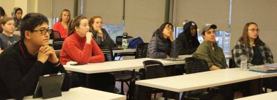 Students in the Climate Corps class listen to one of the presentations about sea level rise impacts.