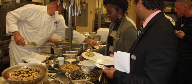 Juliet Wong, center, and Jude Mascarenhas, right, sample dishes using kelp prepared by chef Jeff Trombetta. left, during an event at the Sheraton Hartford South on Dec. 13. Wong is the hotel's convertion services manager and Mascarenhas is its director of operations.