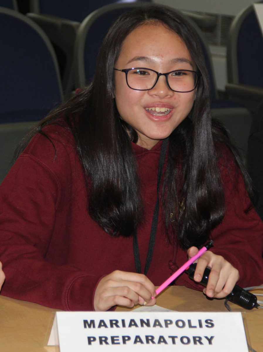 Rosa Nguyen, captain of the Marianapolis Preparatory School team, answers a question during the semi-final round of the contest.