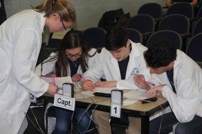 The team from the Bridgeport Regional Aquaculture school works on one of the written answer questions.