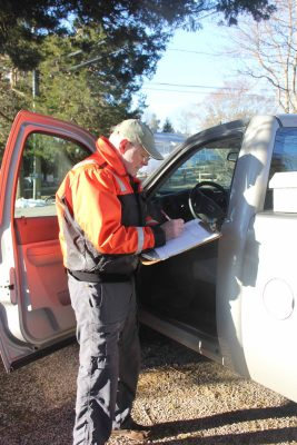 Murphy logs the time and date of a water collection before heading to the next sampling site.
