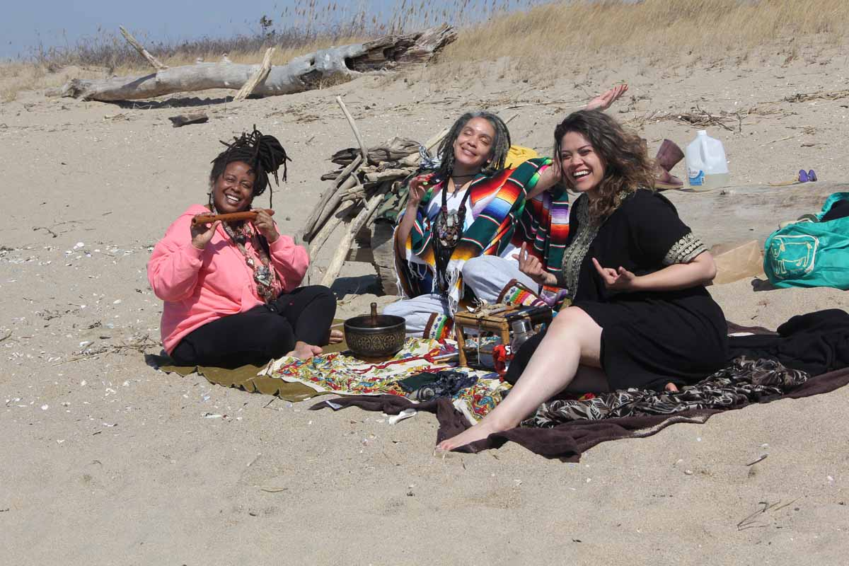 Toni Johnson, right, Azua Echevarria, center, and Andrea Cortez, all of Hartford, enjoyed the first day of spring at Hammonassett on March 20 as the release of the first Long Island Sound Blue Plan was announced.