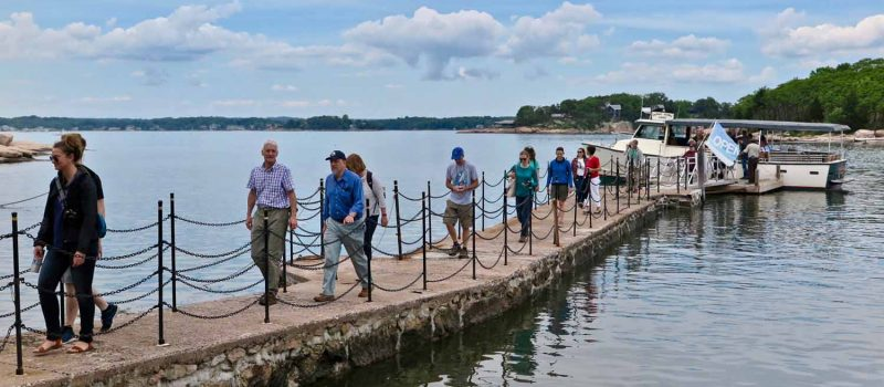 Passengers get off the Volsunga IV on the dock at Outer Island during an On-the-Water Workshop in Branford on June 7.