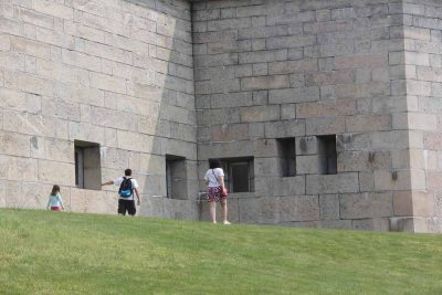A family searches for clues at Fort Trumbull during the Thames River Quest.
