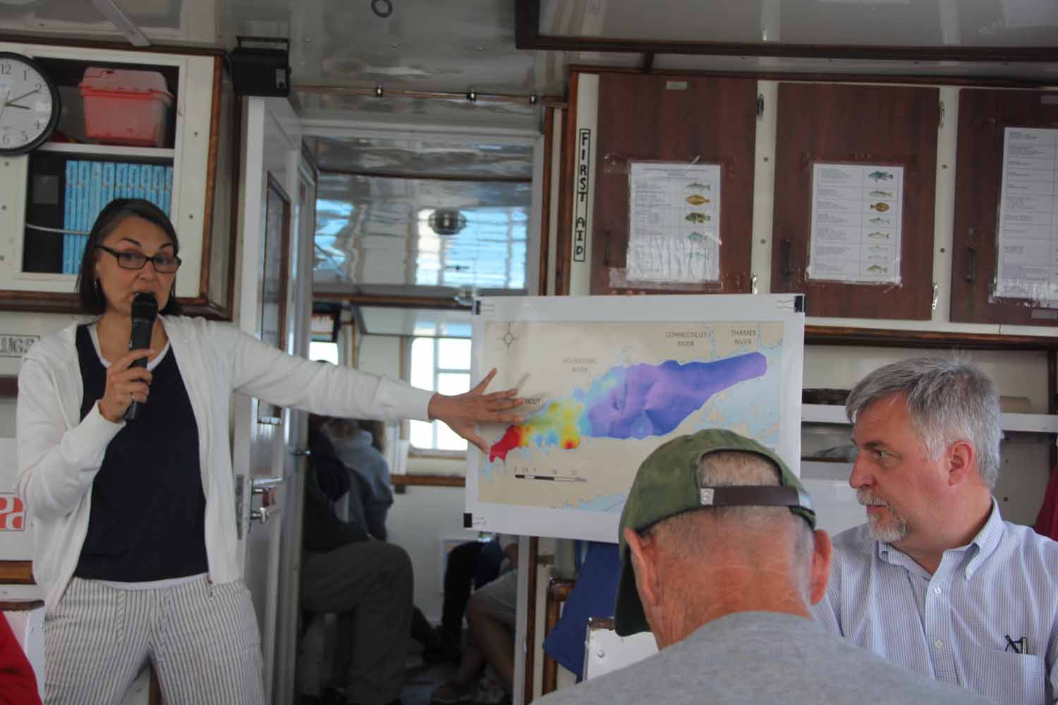 Marine Science Prof. Penny Vlahos shows a map of the extent of hypoxia in Long Island Sound as she describes her research into the biogeochemical processes in the estuary.