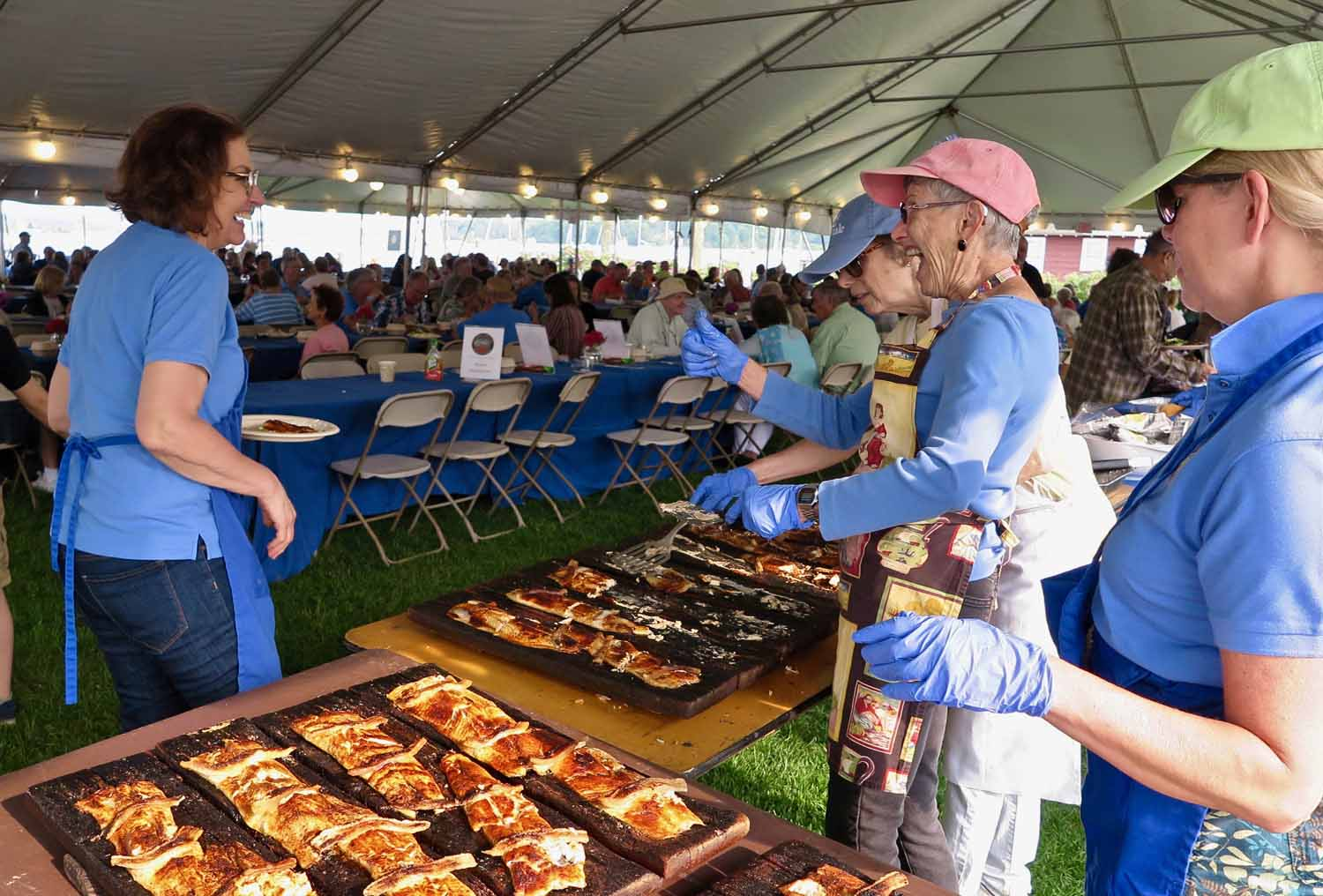 he 61st Essex Annual Shad Bake relies on dozens of volunteers as servers, setup crews and cooks.