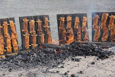 Fillets of shad caught on the Connecticut River by commercial fishermen during the spring is cooked on wooden planks over a wood fire.