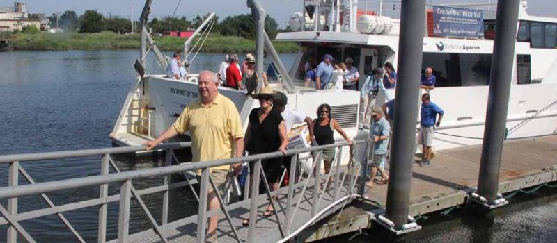 Passengers walk toward the docks at the Maritime Aquarium in Norwalk after the July 26 On-the-Water Workshop aboard Spirit of the Sound.