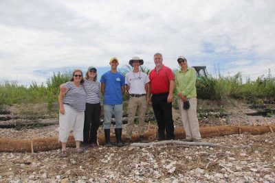 First, second and fifth from left, Syma Ebbin, Nancy Balcom, and Sylvain De Guise, research coordinator, associate director, and director, respectively, of Connecticut Sea Grant, gather at the site with Chris Hauser, third from left, associate director of Delaware Sea Grant, University of Delaware student Sam Koeck, fourth from left, and Sacred Heart University Prof. Jennifer Mattei, far right.