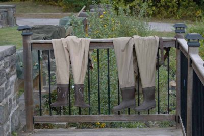 Two pairs of waders dry in the sun outside the Norrie Point center.