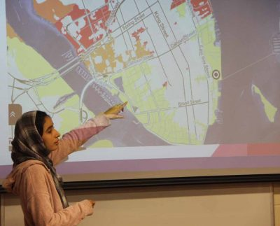 Nissrine Essafi, a student in the Climate Corps class, shows a map of Charleston, S.C., during a presentation on Dec. 6 of a project about sea level rise impacts.