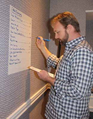 Joshua Reitsma, fisheries and aquaculture specialist at Woods Hole Sea Grant, lists challenges contributed by members of the regulations work group.