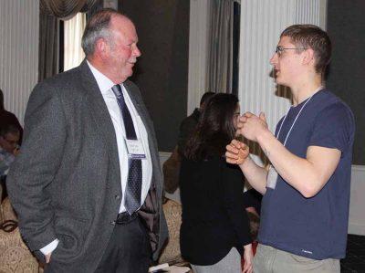 UConn Professor Charles Yarish, left, talks to a symposium participant after his keynote presentation.
