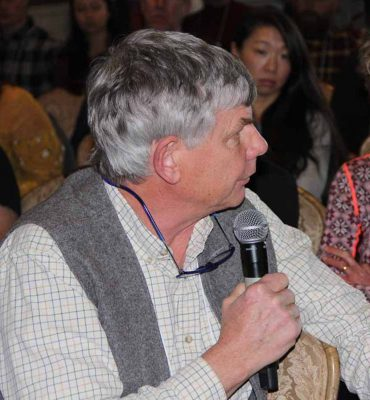 Joth Davis, a grower and researcher with a shellfish farm on Thorndyke Bay in Washington state, asks a question to one of the presenters.