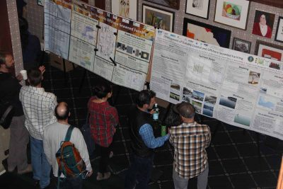Participants discuss poster displays about seaweed research during the Seaweed Showcase.